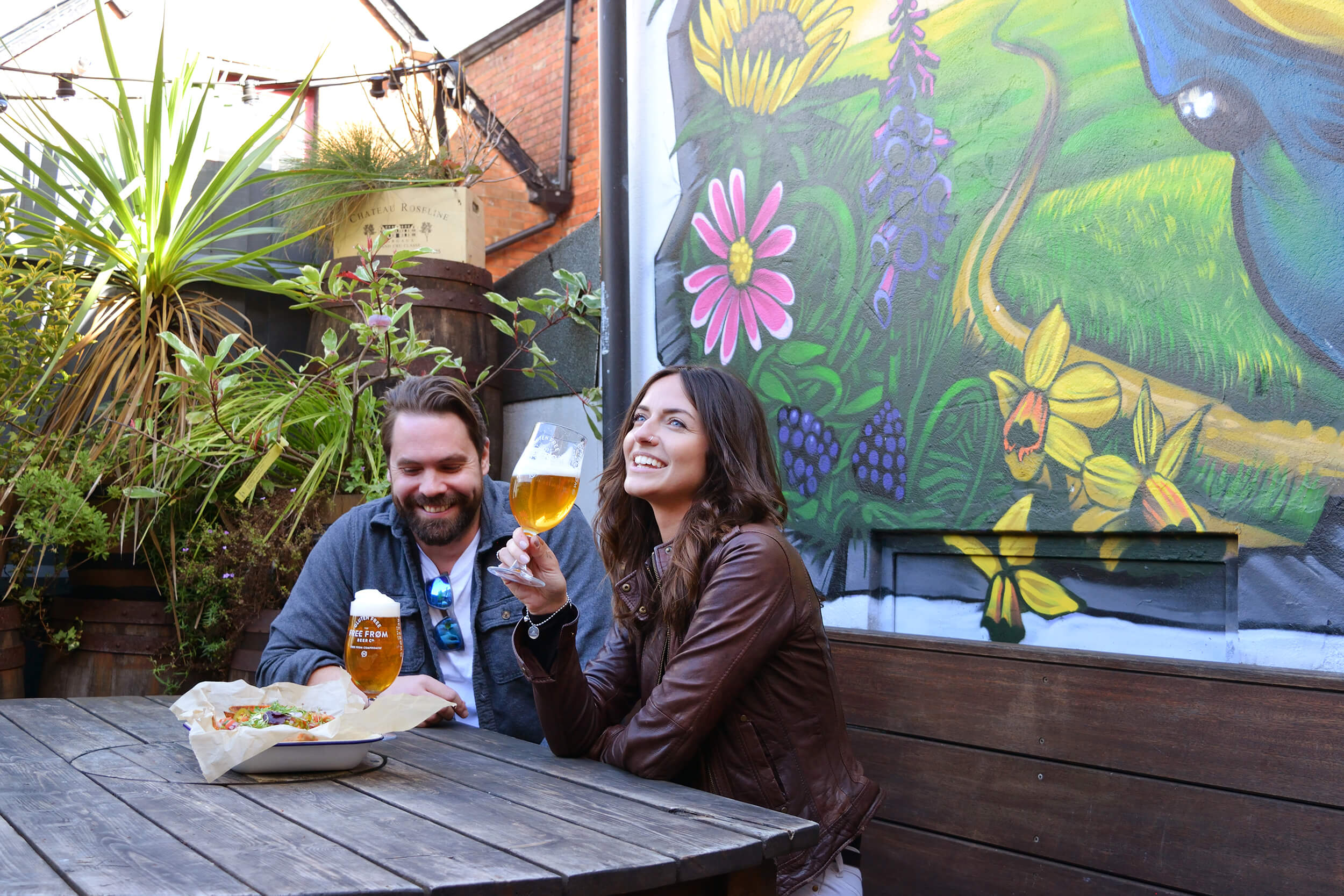 Man and women enjoying a cold Free From Beer in a pub garden